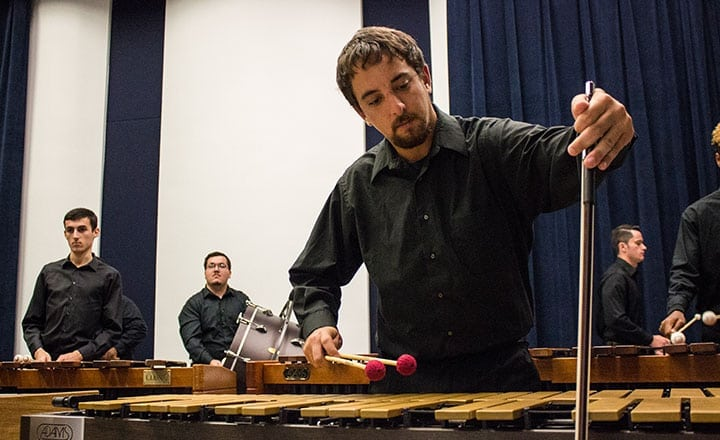percussion ensemble man in black playing xylophone