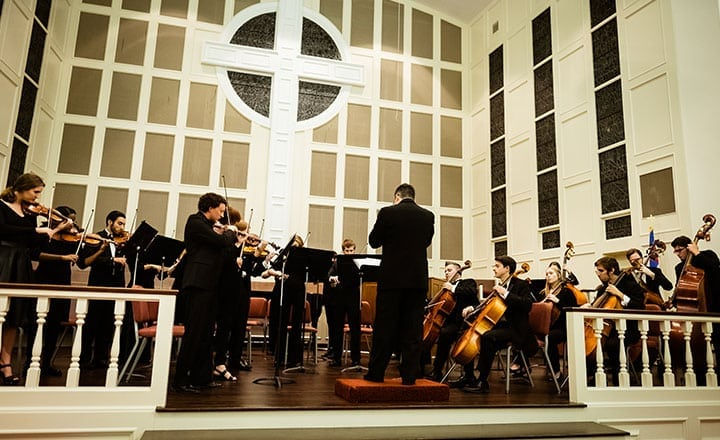 string orchestra playing in a church