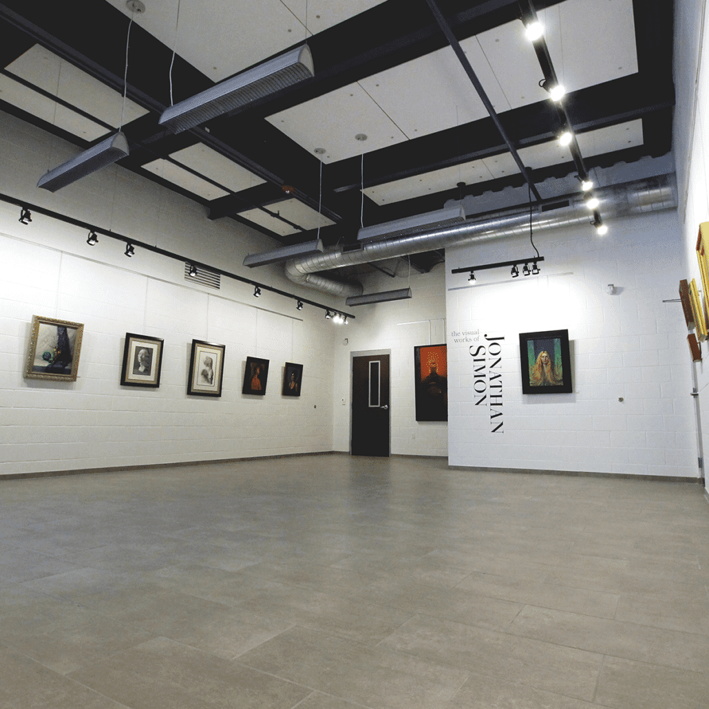 open space industrial gallery with paintings and art on the walls